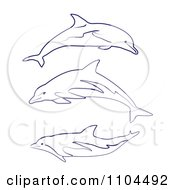 Clipart Outlined Blue Dolphins Royalty Free Vector Illustration by merlinul