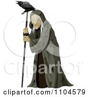 Evil Old Witch In A Torn Cloak With A Raven On Her Walking Stick