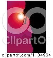 Silhouetted Rock Mountain Climber Against A Red And Pink Sunset