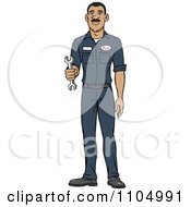Happy Hispanic Male Auto Mechanic Holding A Wrench