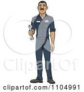 Happy Hispanic Male Auto Mechanic Holding A Wrench