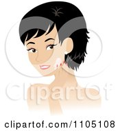 Black Haired Woman Washing Her Face Or Applying Cream