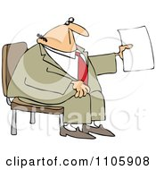 Businessman Sitting And Holding Up A Piece Of Paper