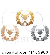 Clipart Bronze Gold And Silver Tropy Cups And Laurels Royalty Free Vector Illustration