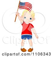 Happy Blond Patriotic American Boy Waving A USA Flag
