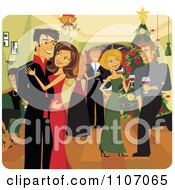Happy Christmas Couple Kissing Under Mistletoe At A Party