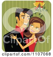Happy Christmas Couple Kissing Under Mistletoe Over Green Stripes