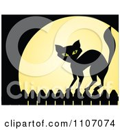 Black Cat Standing On A Fence Against A Full Moon On Halloween