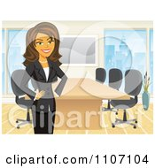 Clipart Happy Brunette Businesswoman Standing By A Meeting Table In An Office Royalty Free Vector Illustration