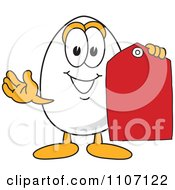 Clipart Egg Mascot Character Holding A Sales Tag Royalty Free Vector Illustration by Toons4Biz