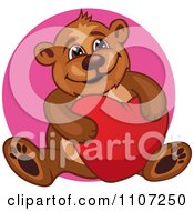 Clipart Happy Teddy Bear Hugging A Heart Pillow Over A Pink Circle Royalty Free Vector Illustration