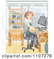 Happy Businesswoman Working On Her Office Computer