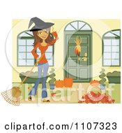 Happy Woman Wearing A Witch Hat And Raking Her Yard For Halloween