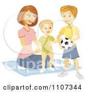 Happy Boy With A Soccer Ball Watching His Mom Help His Baby Brother Stand