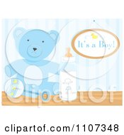Blue Teddy Bear Rattle And Baby Bottle With An Its A Boy Sign