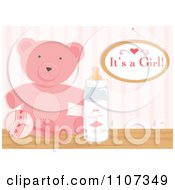 Pink Teddy Bear Rattle And Baby Bottle With An Its A Girl Sign
