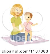 Happy Mother Helping Her Baby Girl Stand