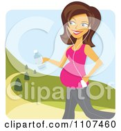 Happy Pregnant Brunette Woman Walking In A Park