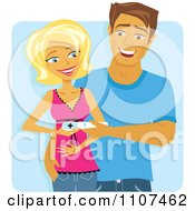 Happy Caucasian Couple Holding A Positive Pregnancy Test Over Blue