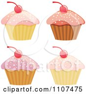 Cupcakes With Pink Sparkly Frosting And Cherries