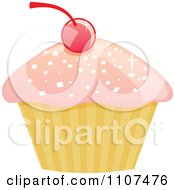Cupcake With Pink Sparkly Frosting And A Cherry 1