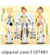 Three Happy Women Using Spin Bikes At The Gym