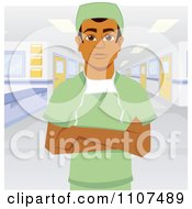 Male Indian Surgeon In Scrubs With Folded Arms In A Hospital