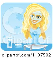 Happy Blond Teenage Girl Washing Her Face With Cleanser Over Blue