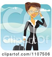 Happy Traveling Brunette Businesswoman Talking On Her Cell Phone At An Airport