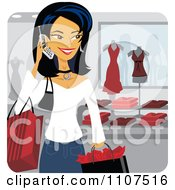 Happy Asian Woman Talking On A Cell Phone While Shopping In A Store