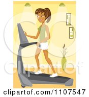 Fit Hispanic Woman Walking On An Treadmill In A Gym