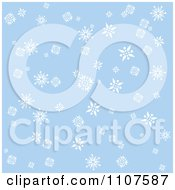 Background Of Falling Snowflakes On Blue