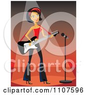 Rocker Chick Playing An Electric Guitar On Stage