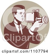 Clipart Retro Camera Man Using A Video Recorder In A Tan Circle Royalty Free Vector Illustration