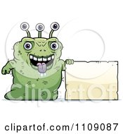 Clipart Ugly Green Alien With A Sign Royalty Free Vector Illustration