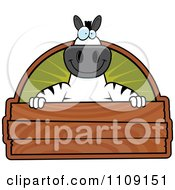 Clipart Zebra Holding A Wood Sign Royalty Free Vector Illustration
