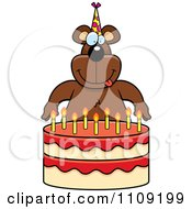 Clipart Bear Making A Wish Over Candles On A Birthday Cake Royalty Free Vector Illustration