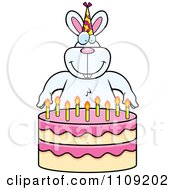 Clipart Rabbit Making A Wish Over Candles On A Birthday Cake Royalty Free Vector Illustration