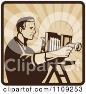 Clipart Retro Male Photographer Shooting With An Antique Bellows Camera On A Square Of Rays Royalty Free Vector Illustration