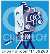 Clipart Retro Movie Video Camera On A Tripod Over Blue Royalty Free Vector Illustration