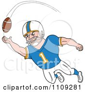 Caucasian American Football Player Receiver In A Blue Jersey Catching A Ball