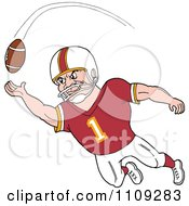 Caucasian American Football Player Receiver In A Burgundy Jersey Catching A Ball