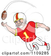 Caucasian American Football Player Receiver In A Red Jersey Catching A Ball
