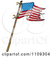 Waving American Flag With Tattered Edges On A Stick