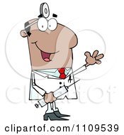 Happy Black Male Doctor Holding A Syringe And Waving