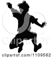 Clipart Silhouetted Boy Jumping Royalty Free Vector Illustration