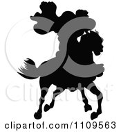 Clipart Silhouetted Caped Rider On A Horse Royalty Free Vector Illustration