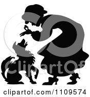 Clipart Silhouetted Old Lady Giving A Dog A Treat Royalty Free Vector Illustration