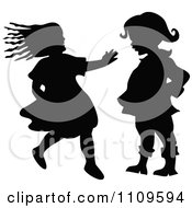 Clipart Silhouetted Girl Running To A Boy Royalty Free Vector Illustration