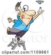 Man Standing On The Top Of A Ladder And Installing A Light Bulb